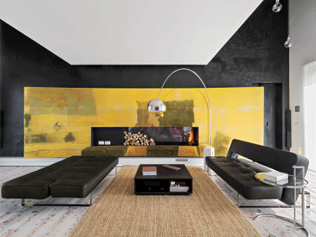 modern living room: two modern leather sofa near to fireplace in the modern living room Stock Photo
