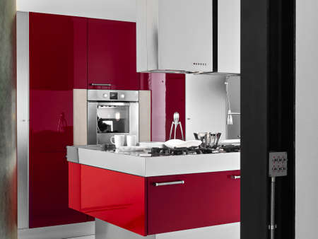 kitchen island: interior view of a modern kitchen on foregound of red kitchen island