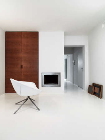 interior view of a modern living room with fireplace and white resin floor