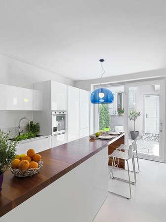 kitchen island: interior view of modern kitchen with kitchen island overlookig on the courtyard