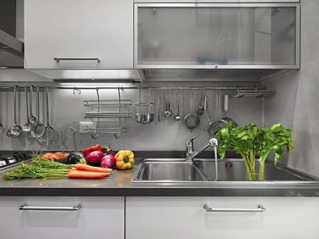 apium graveolens: Detail of sink in the modern kitchen with vegetables