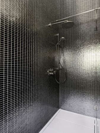 shower cubicle: interior of masonry shower cubicle coated oo mosaic tile Stock Photo