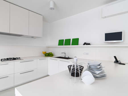 kitchen cabinet: interior view of a white modern kitchen with vegetables and dishes  on the wotktop