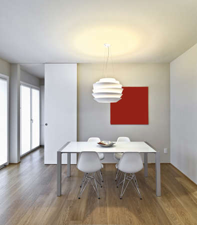 wood room: modern dining table in the living room with wood floor
