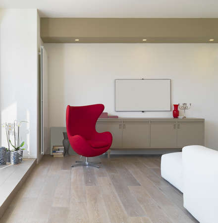 wood room: interior view of a modern living room with red armchair and wood floor