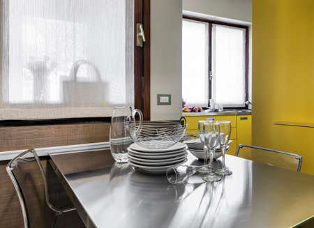 dishes and glass on the table in the modern iiving room
