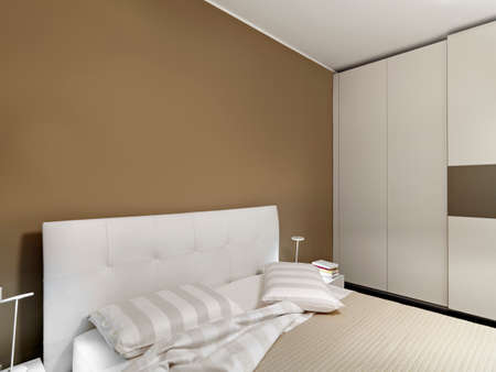 interior home: interior view of a modern bedroom in foreground the bed with pillow Stock Photo