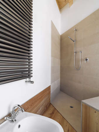 shower cubicle: interior view of a modern bathroom in foreground the masonry shower cubicle coated of marble Stock Photo