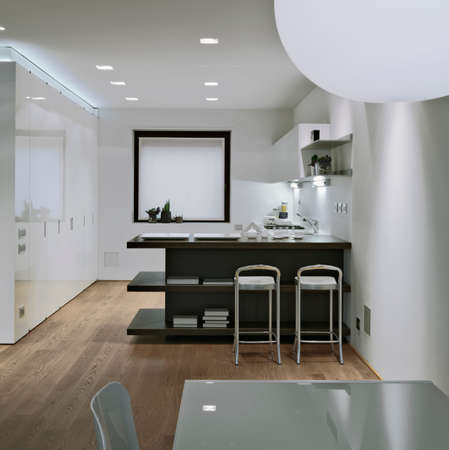 interior view of a modern kitchen in foreground the dining table and wooden floor