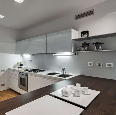 interior view of a modern kitchen in foreground on the  woode nworktop the pottery