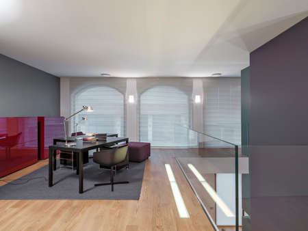 furnishings: desk and chair in the loft with wooden floor and carpet