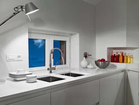 detail of modern kitchen foreground of sink in the attic room Lizenzfreie Bilder