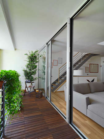 balcony with wood floor overlooking on the modern living room and staircase Standard-Bild