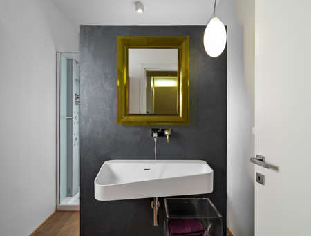 interior view of a modern bathroom i foreground the washbasin