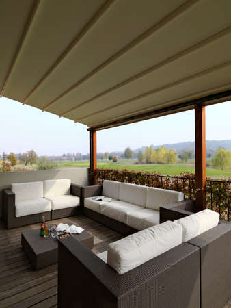 modern fabric sofas and wicker in the  porch overlooking on the golf course