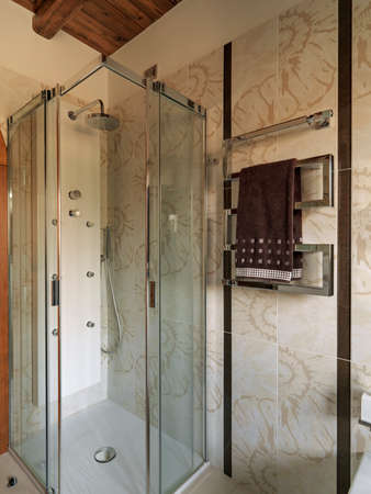 internal shooting of a modern bathroom in foreground the shower glass cubicle Standard-Bild