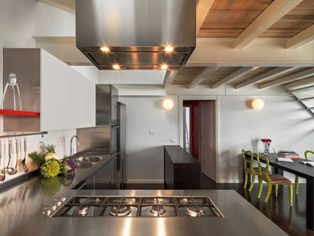 internal shots of a modern kitchen in foreground the steel cookers Standard-Bild
