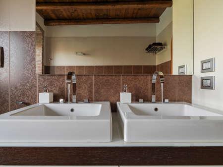 interior view of modern bathroom in foreground two washbasin Lizenzfreie Bilder