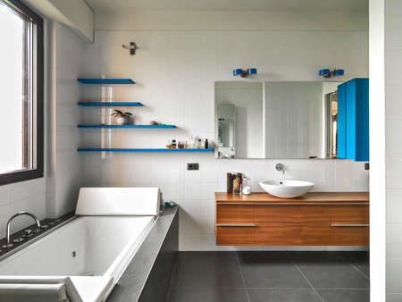 interior view of a  modern bathroom in the foreground the bathtub
