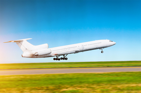 White russian airplane takes off at the airport against a background of clear sky. Stock Photo