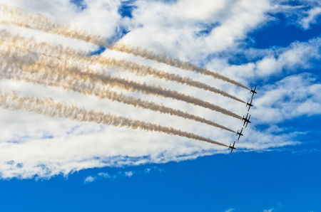 Aircraft fighter jets smoke the background of blue sky white clouds.