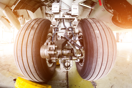 Landing gear airplane in hangar chassis rubber close-up.