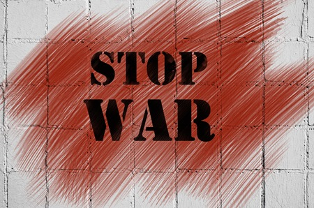 smeared: The inscription on the brick wall is a stop war. On abstract blood smeared.
