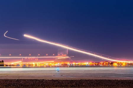 Landing strip light stock photos royalty free business images night lights tracks of lights in the movement of aircraft on long exposure mozeypictures Gallery