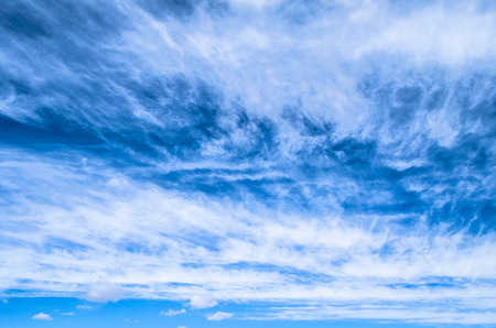 Fluffy small cirrostratus , cirrocumulus and cirrus cloud formations blue sky Stock Photo