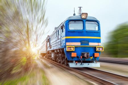 Locomotive in the composition of a passenger train in motion at speed Stock Photo
