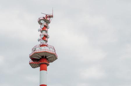 Modern tower, lighthouse radar and cloudy sky Stock Photo