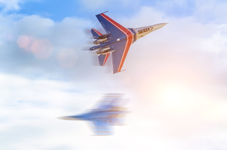 Two fighters meet in the sky at high speed Stock Photo