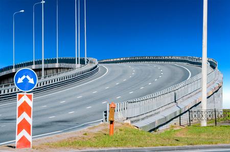 overbridge: Viaduct road marking asphalt up and road sign