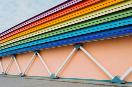 colorfull: Wall of the building, supports in the form of pipes, and roofs illuminated in the form of a rainbow