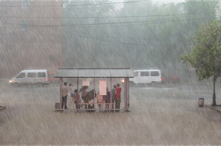 Crowd of people are hiding from heavy rain at a stop in the city