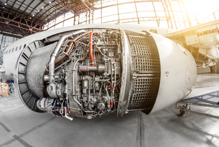 Engine of the aircraft with an open hood for repair and inspection