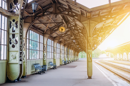 Vintage retro platform passenger railway station. Concept of meeting, waiting, seeing people on the road trip
