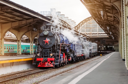 Old steam locomotive at an antique vintage train station Stock Photo