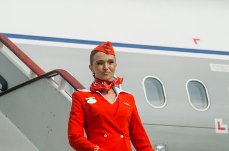 saint: Charming Stewardess Dressed In Red Uniform. Russia, Saint-Petersburg. August 10, 2017 Editorial