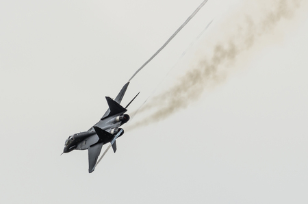 sharply: Aircraft fighter flies sharply turns with smoke from engines