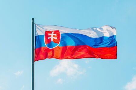 Waving colorful Slovakia flag on blue sky