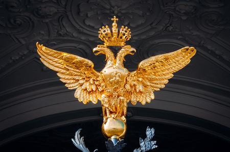 two-headed golden shine eagle on dark background Stock Photo