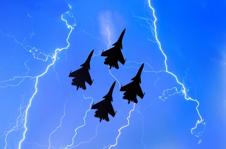 Group of combat fighters jet against the background of lightning thunderstorms weather at night Stock Photo