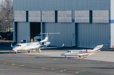 luxurious: Several business jets at the hangar parking. airport Pulkovo, Russia Saint-Petersburg October 30, 2014 Editorial