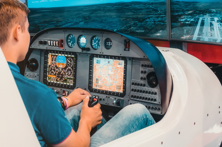 Simulator of a passenger aircraft with a cockpit and pilots Standard-Bild