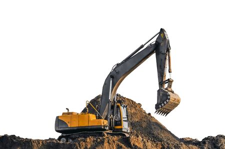heavy industry: Excavator work on the ground on background of multi storey houses