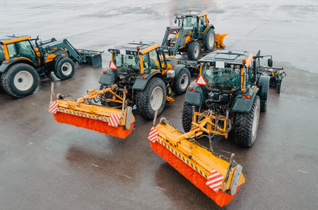 Snowplows Tractors on the airfield at the airport. Snowblower