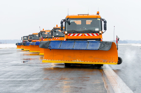 Snowplows in the work on the runway at the airport