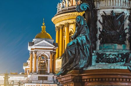 Night view of the ancient statues of stucco and the dome of St. Isaacs Cathedral Petersburg