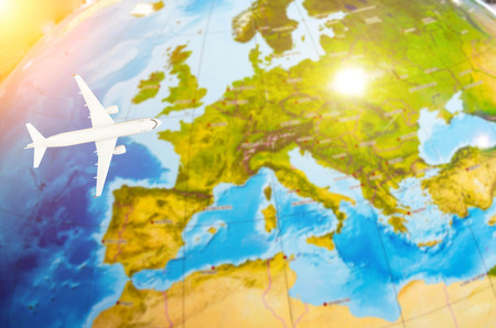 Flight to Europe symbolic image of travel by airplane map Stock Photo